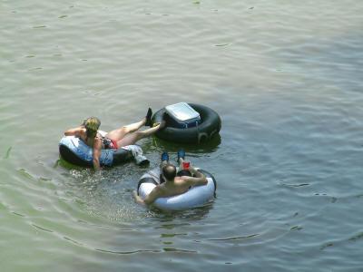 People floating on tubes